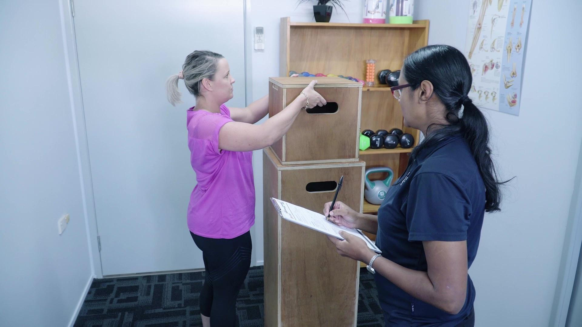 Physiotherapist conducting a pre employment assessment on a worker